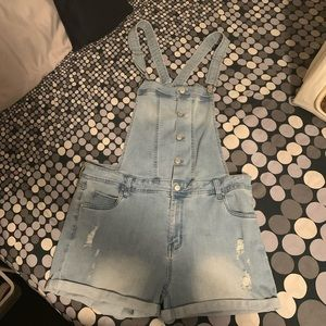 Celebrity pink overall jean shorts